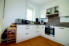 Edel wohnen in den Nymphenburger Innenhöfen - 3-Zimmer-Wohnung im 5.OG mit 2 Balkonen - Küche Bild 1