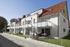 Charmante 2-Zimmer-Wohnung mit Garten - Ansicht Mehrfamilienhaus